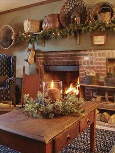 Garland and baskets above fireplace - country Christmas decorating