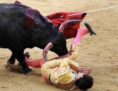 Matador Sebastian Castella is gored during in Pamplona, north of Spain.