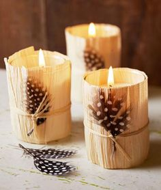 Wrap glass votive holders in textural flair. Tie raffia around three or four overlapping moistened corn husks trimmed to fit. A spotted guinea fowl feather (available at crafts stores) adds a flourish.