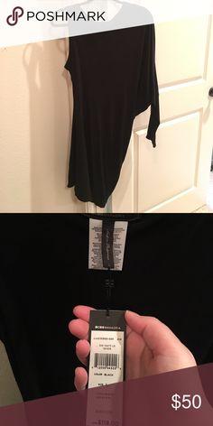 BCBG Large Asymmetrical Black Dress This dress has one Sleeveless arm and one long sleeve arm. BCBGMaxAzria Dresses Mini