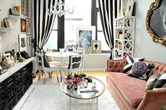 Make Every Detail Count - Many people with small spaces lament that they can't fit more decor into the mix. But if you carefully choose each piece, you may be surprised at the amount of detail you're able to include! A tufted sofa, striped draperies, a chandelier and geometric shelving make a big statement in this space.