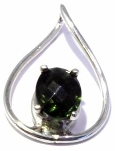 This gorgeous pendant features a faceted Moldavite set in Sterling Silver.  The back is stamped 925.  This pendant is the perfect accessory for a night on the town and is a great gift for that special person in your life