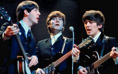 sirpeter64:  Beatles: Three voices one microphone. Digitally restored press image.