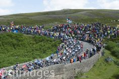 The peloton rides over a bridge on Grinton Moor as stage one of the Tour de France passes over the Grinton Moor, Yorkshire.