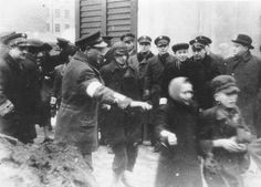 Jewish children walking single-file in the street before their deportation to Treblinka, Warsaw Jewish History, World History, Ww2 History, Warsaw Ghetto, Warsaw Poland, Evil People, Never Again, Lest We Forget, Persecution