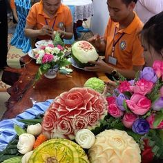 """Flowers from fruit - students at the Vientiane province vocational training centre are learning to carve flowers into fruit. These students are training in hospitality and tourism; the """"flowers"""" would be displayed as table centrepieces in hotels and at official banquets. #laos #vocationaltraining #training #vientiane #tourism #hospitality #laostudents #asia #eatdrinklaos   Eat Drink Laos http://eatdrinklaos.com"""