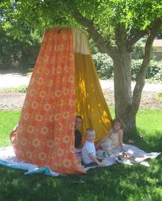 3 twin sheets & hula-hoop & rope = outdoor fort!!