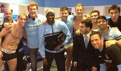 Superstar fan: David Hasselhoff posed with the Manchester City players in the dressing room at the Etihad