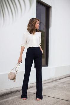 Mid sleeve length mesh off white button up blouse with casual black wide leg trousers. And taupe bag match to match