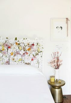 Floral headboard DIY | creamylife blog...You could do this with a trellis from a home improvement store and some paper flowers...cute idea!