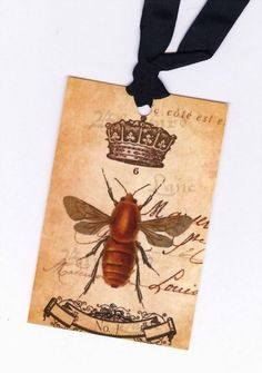 """Gift Tags French Bee and Crown-Set of six, approx. 2 5/8"""" x 4"""".-Antique French look bee and crown, very elegant! Topped with seam binding and ready for all your needs. Use as hang tags, place cards, tie-ons.-$6"""