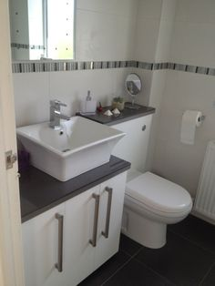 Grey Grout With White Brick Pattern Tiles With Bathroom