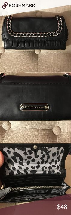 "Betsey Johnson clutch Betsey Johnson leather clutch with silver chain detail and ruffle leather trim. Leather has minor signs of wear and some fading. Inside it has 4 credit card compartments, bill slots, and zippered coin purse in middle. Bag measures 7.5""x4""x1"" Betsey Johnson Bags Clutches & Wristlets"