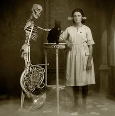 Unexplained black and white photos--just weird?  shells in her ears, black cat and skeleton--Halloween?