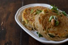 Curried Noodle Patties - A great way to use up leftover noodles. These savory noodle cakes make a great lunch and are easily adaptable a hundred different ways. - from 101Cookbooks.com