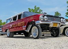 1960 Chevy Impala 4dr wagon done up in old Gasser race car style. Straight axle front, chrome reverse rims, wide white wall, cheater slicks, and luv those fish tail pipes on the fender-well headers.
