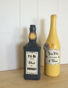 Add some rustic flair to any wedding or home with Honeybee country song lyrics on decorative bottles! Liquor bottles are painted, distressed, and decorated with floral and rhinestone embellishments Honeybee song lyrics sealed onto each bottle on a Jack Daniels style label Genuine wine bottle and Jack Daniels whiskey bottle Each painted bottle is sealed for an even finish Perfect decor for a country wedding or rustic home! Dimensions: wine bottle 3w x 12 h, whiskey bottle 4w x 10h Want this…