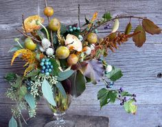 Saipua (persimmon branches and porcelain berries with pale peach, mustard, and amber flowers and foliage)