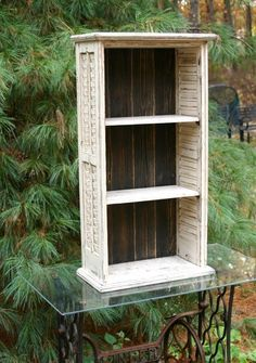 Neat repurposed shutter bookcase with shelves with distressed paint!
