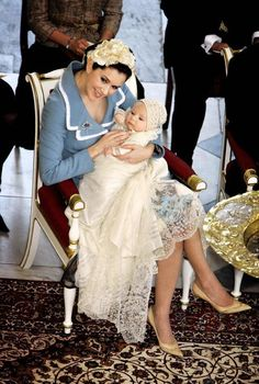 Crown Princess Mary of Denmark cradles her son and heir to the Danish throne Crown Prince Christian of Denmark as they arrive for the Royal Christening ceremony at Christiansborg Palace Church on January 21, 2006 in Copenhagen
