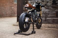 In the idyllic English countryside, on a farm just north of London, you'll find an extraordinary custom workshop; Yamaha Motorcycles, Custom Motorcycles, Custom Bikes, Cars And Motorcycles, Workshop Cafe, Lion's Den, Bike Builder, Cafe Racer Style, Ford Raptor