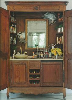 """Bryan Batt, of Mad Men, is also a designer. He repurposed his armoire and made it into a full wet bar. Or a """"barmoire"""" as they were calling it on the Nate Berkus Show. haha"""
