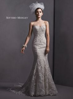 Strapless lace fit and flare wedding dress with Swarovski crystal embellishments along a sweetheart neckline, Stella by Sottero and Midgley.