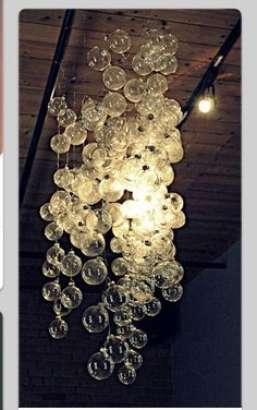 Decorating with lights 20 diy string light projects pinterest this diy bubble chandelier uses clear ornaments but you could also add colored ornaments for a little party pop just a bit of fishing wire ornaments and mozeypictures Choice Image