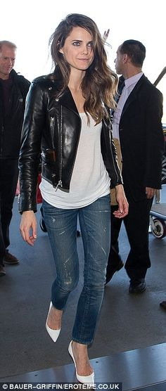 Back home: Following the TCA talk on Day 6 of the tour, Keri was seen at LAX airport in the same leather jacket along with all her bags