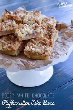 gooey white chocolate chip fluffernutter bars; a homemade cake base ...