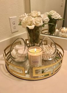 IM OBSSED with the bathroom piece I put together. -Gold Tray: kirklands -Glass … IM OBSSED with the bathroom piece I put together. -Gold Tray: kirklands -Glass containers: TJ Max -Candle: target Source by Bathroom Countertops, Bathroom Cabinets, Countertop Decor, Makeup Organizer Countertop, Restroom Cabinets, Vanity Countertop, Bathroom Shelves, Glass Shelves, Glass Containers