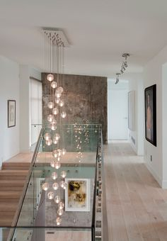 great space for displaying art & love the cascading glass light fixture. design by tanya schoenroth.