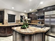 Transitional Kitchens from Addison Bruley LLC on HGTV. Thick quartz countertops contrasting dark cabinetry and tile floors.