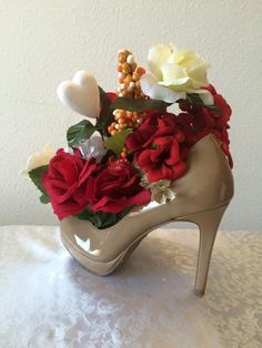 To order your custom made floral shoe arrangement email me at fashionm4women@yahoo.com  or order from http://www.bonanza.com/booths/Fashionm4women  © 2015 fashionm4women.  All Rights Reserved.
