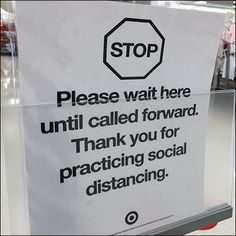 """""""Patience please"""" urges this CoronaVirus Wait-Here Self-Checkout Instructions notice. Even though this is part of the Self-Checkout Queue, wait for staff to"""