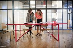 Stock-Foto : woman discuss architectural plans