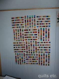 Postage stamp quilt - strips of little squares separated by white