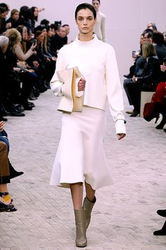 Céline Fall 2013: Beautiful lines. Not loving the too long sleeves, although I like length. Clutching clutch.