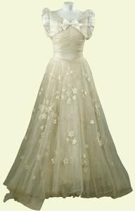 Princess Margaret's maid of honour gown designed by sir Norman Hartnell for Princess Elizabeth's wedding.