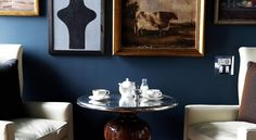 Contemporary design. Eclectic mix on framed pictures create personality.