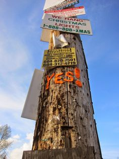 nirvYARNah: If you were waiting for a sign, this is it! Public art yarnbombing, 2015.