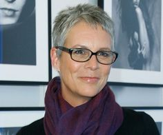 Actress Jamie Lee Curtis is artistic and chic with this salt and pepper pixie, black-rimmed glasses, and cool-toned scarf. Poetry reading, here she comes.