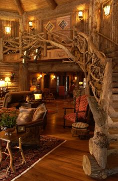 Natural lodge pole pine handrail for this cabin staircase