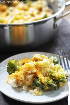Serving of One Pan Cheesy Chicken Broccoli Rice Casserole on a plate, with full pan in the background.