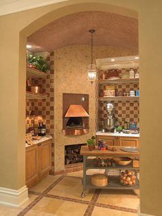 Tour 10 Amazing Kitchens : Rooms : Home & Garden Television   Could we incorporate a pizza oven in out kitchen?