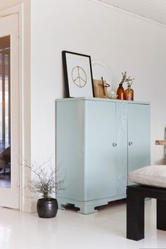 Light green furniture and peaceful details