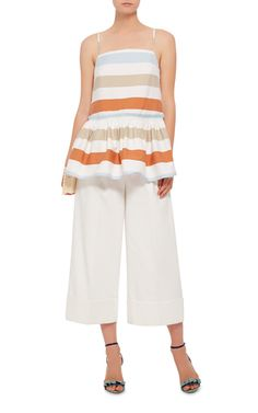 From the young, emerging designer comes this **Tanya Taylor** top with colorful wide stripes and a feminine peplum hem.
