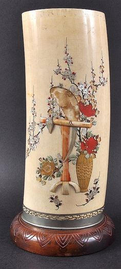 A 19TH CENTURY JAPANESE MEIJI PERIOD IVORY SHIBYAMA TUSK VASE decorated with doves perched upon a stump amongst foliage. Few lacquer losses. Ivory 12ins high.