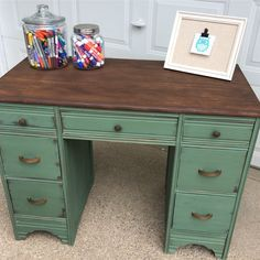 Hi! My name is Sage! My name means wise and knowing. Who has heard the saying thats of Sage advice? Well now we know what that statement means. I am a timeless desk with classic lines fantastic hardware and outstanding paint and stain combination. I am a desk that was found at @thewelliowa and was given a paintover and some TLC. My body is painted in a gorgeous Sage Green chalk paint and distressed heavily for the dark chestnut brown wood to show thru as the red tones compliment the stunni Chalk Paint Desk, Chalk Paint Furniture, Diy Furniture, Refinished Desk, Green Painted Furniture, Desk Redo, Green Desk, Home Office Setup, Brown Wood