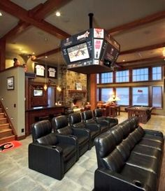 """ManCaveHeaven: Second angle of one of the room.  I hope that's a bar in the back. Cool """"guy's"""" room."""